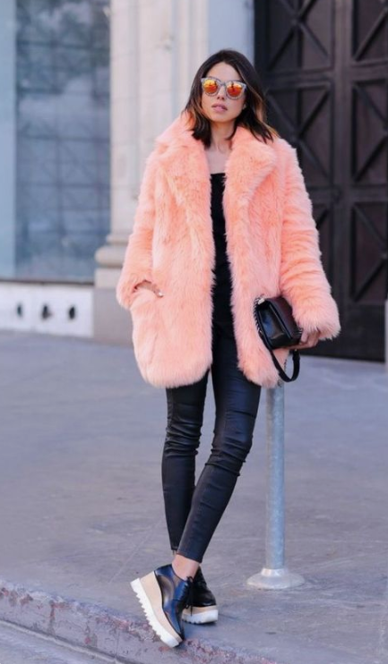 a comfy everyday look with a black top, leather leggings, platform shoes and a peach-colored faux fur short coat