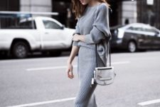 a comfy grey knit dress with long sleeves and a high neckline, white sneakers and a white bag