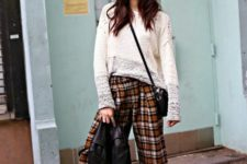 a creative outfit with a neutral long sleeve top, plaid cropped pants, printed slipons and a black leather jacket