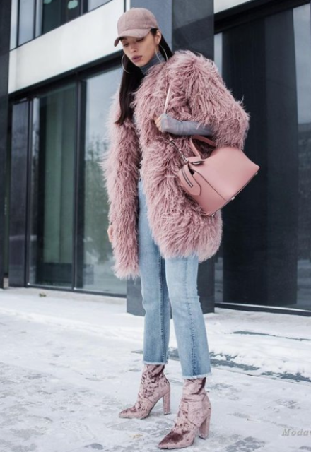a dusty pink faux fur knee coat, matching crushed velvet booties and a matching bag for a chic look