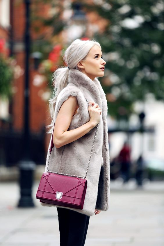a fall or winter look with a white top, black skinnies, a grey faux fur waistcoat and a bold fuchsia box bag