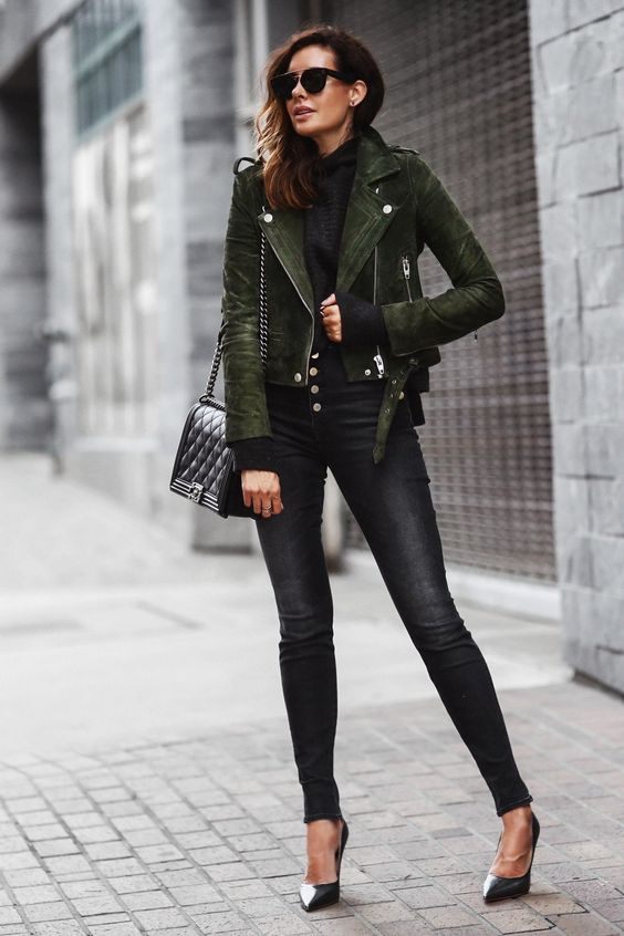 a fall outfit with black hihg waisted jeans, a black turtleneck, black heels, a green suede jacket and a black box bag