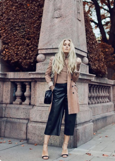 a gorgeous fall look with a tan turtleneck, a coat, black leather culottes, a black bag and two tone shoes