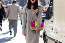 a grey knit midi dress with long sleeves and a V-neckline, white sneakers, a scarf, a colorful bag and socks