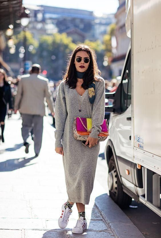 a grey knit midi dress with long sleeves and a V neckline, white sneakers, a scarf, a colorful bag and socks