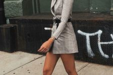 a grey plaid blazer mini dress with a belt, black and white cowboy boots for a chic look