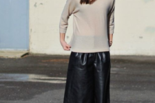 a minimalist look with a tan turtleneck, black leather culottes and tan ankle strap shoes