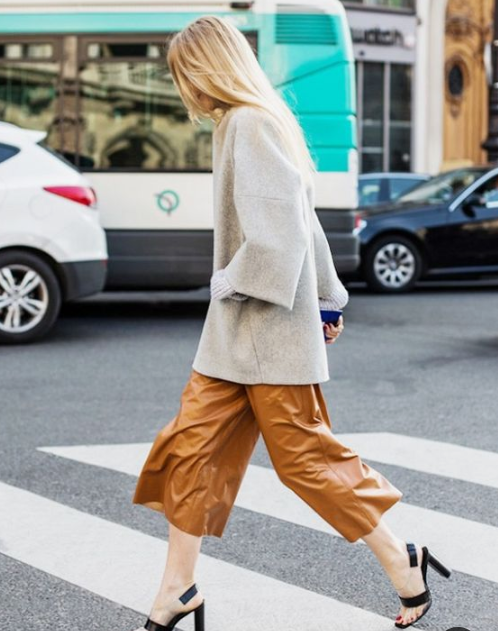 a minimalist look with an oversized gren sweater, amber leather culottes, black and sheer shoes