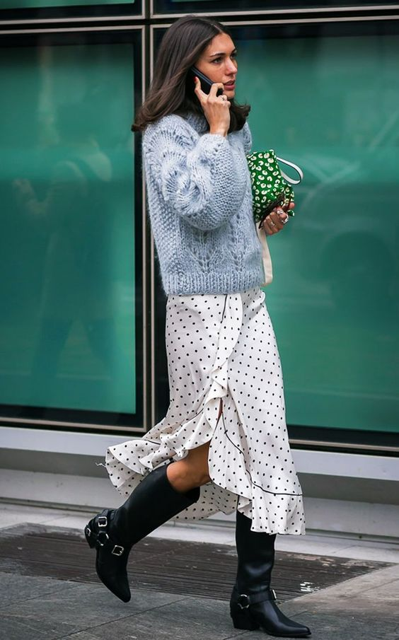 a powder blue sweater, a polka dot wrap midi skirt, black cowboy boots for winter or fall