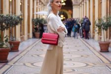 a romantic look with a white jumper, a color block tan and white midi, mules and a red box bag