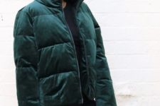 a total black look accented with a forest green velvet puffer jacket for a trendy feel