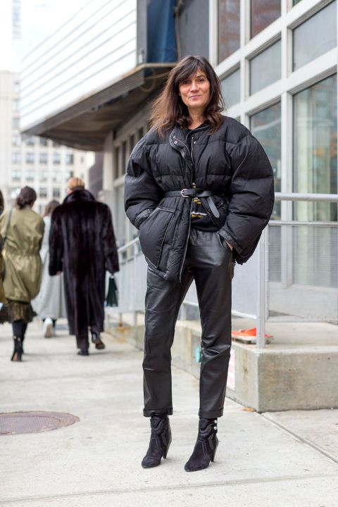 a total black look with leather pants, suede booties, an oversized puffer jacket with a belt