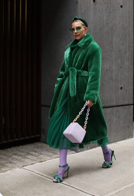 a whimsical look done in emerald and purple with a midi emerald faux fur coat for a refined touc