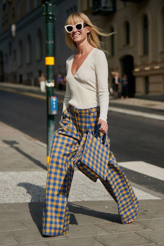 a whimsy and bright outfit with a neutral top, colorful plaid wideleg pants and a matching bag for the fall
