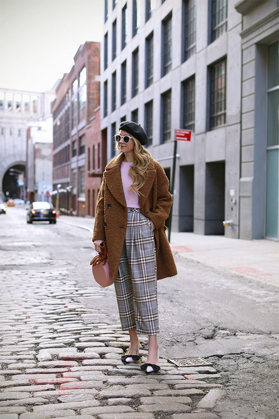 a whimsy and girlish outfit with a pink top, plaid cropped pants, bow heels, a teddy bear coat and a pink round bag