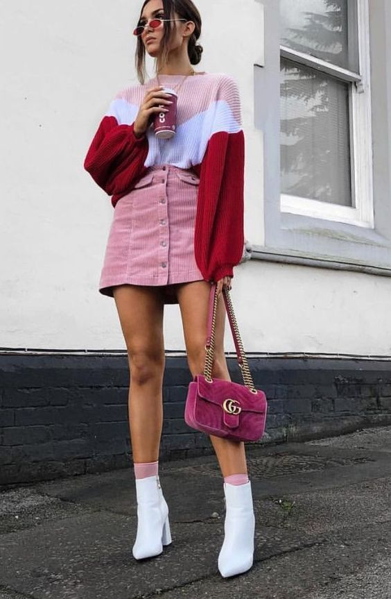 a whimsy look with a color block sweater, a [ink velvetine skirt, white booties and a hot pink box bag