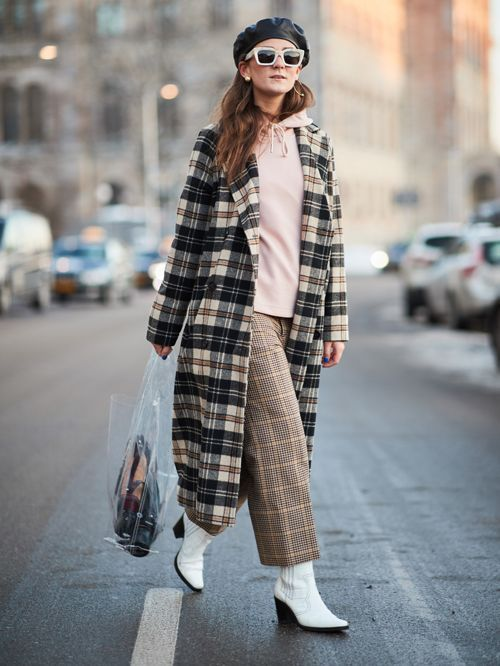a whimsy outfit with a pink hoodie, cropped wideleg pants, white booties, a plaid coat and a sheer bag