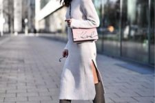 a white knit midi dress with a side slit and a turtleneck, grey wide knee boots and a pink bag