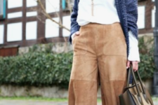 a white long sleeve jumper, a navy oversized cardigan, tan leather culottes, animal print shoes and a black bag
