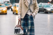 a winter look with a neutral turtleneck, plaid wideleg pants, black boots, a neutral shearling coat and a fringe bag