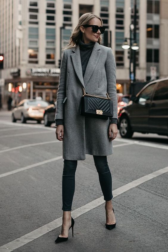 an elegant fall outfit with a grey turtleneck, black cropped skinnies, black heels and a grey coat plus a black box bag