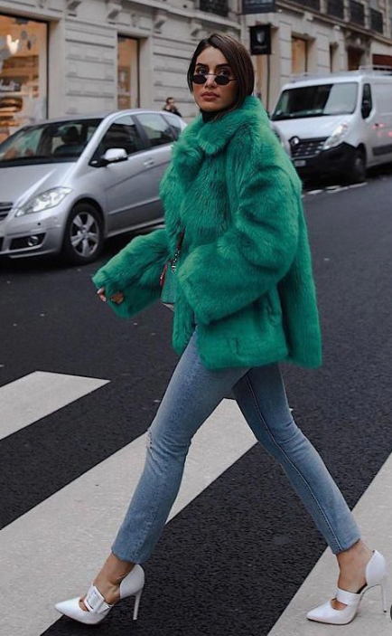 an emerald faux fur coat for a touch of color and for an edgy look this winter