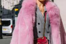 spruce up your everyday work look with a suit with a bright faux fur coat like here – a pink one