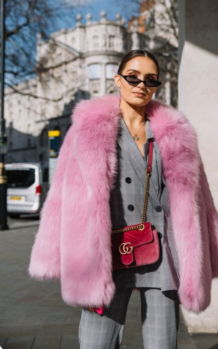 spruce up your everyday work look with a suit with a bright faux fur coat like here - a pink one