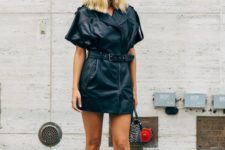 02 a black leather mini dress styled as a moto jacket, black shoes and an animal print bag