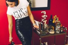 02 a printed tee, a black sequin pencil skirt, black shoes and statement earrings for NYE