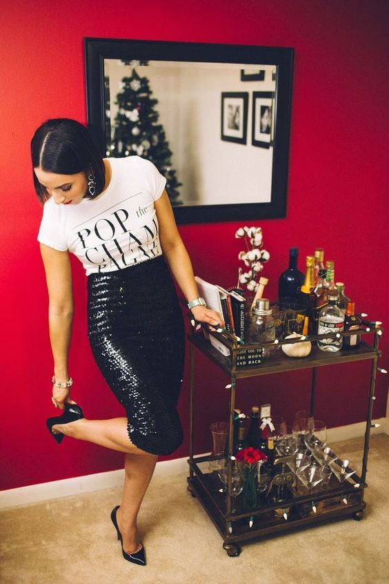 a printed tee, a black sequin pencil skirt, black shoes and statement earrings for NYE