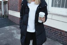 02 a simple monochromatic look with a white long sleeve top, black leggings, white sneakers and a black puff coat
