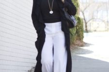 02 a stylish look with white pants, a black top, black heels, a black bag and a long cardigan