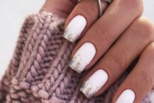 02 matte white nails with colorful glitter on the tips is a stylish and glam idea