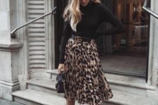 03 a black turtleneck, nude shoes and a black bag plus a statement animal print pleated skirt