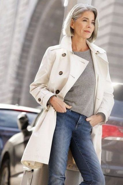 blue jeans, a grey t shirt and a white trench for a stylish casual look that inspires