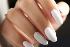 03 matte white nails with a single nail with metallic glitter that looks spilled on the nail