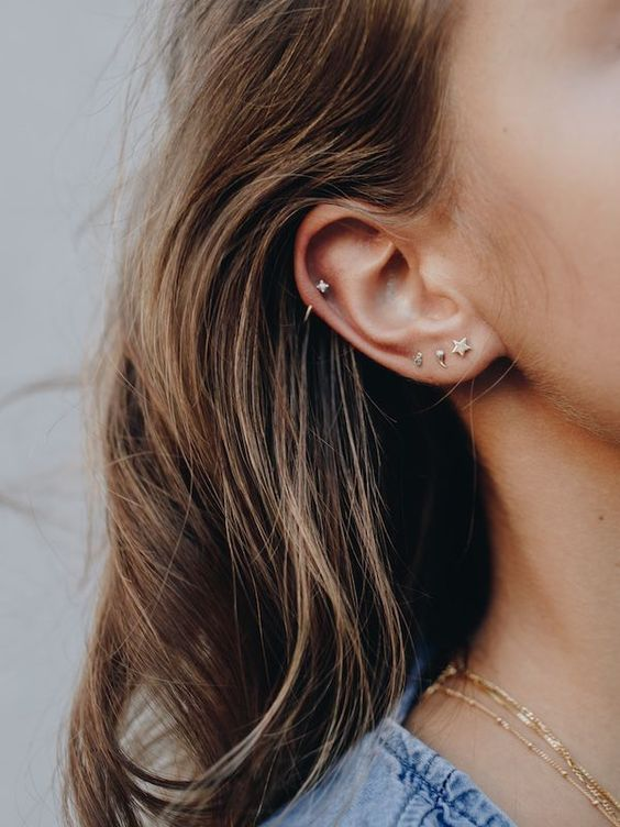 mini gold studs that match look like a whole earring set and are great for minimalists