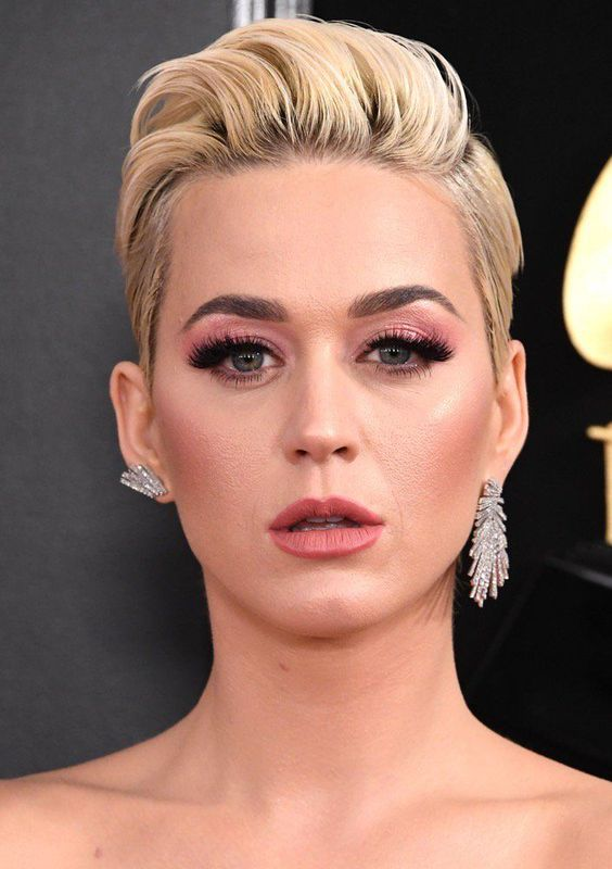 mismatched rhinestone earrings of different shapes but in the same style by Katy Perry