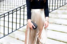 04 a chic outfit with a black long sleeve top, a metallic pleated midi skirt, nude shoes and a black clutch