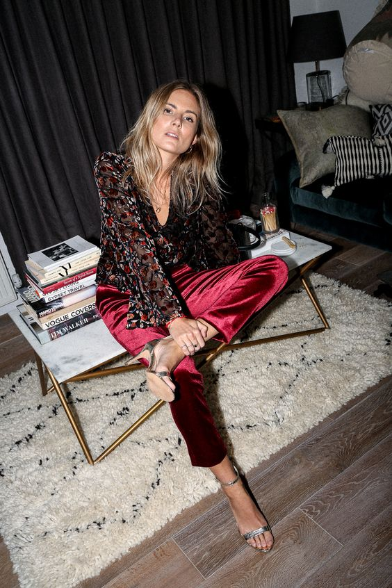 a dark floral shirt, burgundy velvet pants and silver heels for a boho party outfit