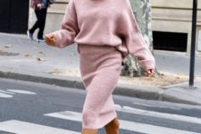 04 a girlish look with a pink knit suit with an oversized sweater, a pencil skirt and snake print shoes