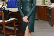 04 a green knee leather sheath dress with a high neckline, long sleeves and black heels for a sexy look