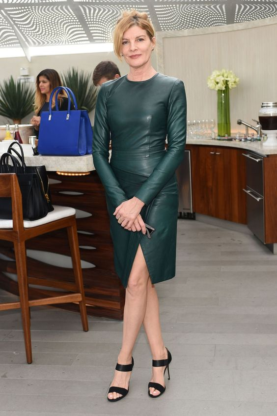 a green knee leather sheath dress with a high neckline, long sleeves and black heels for a sexy look