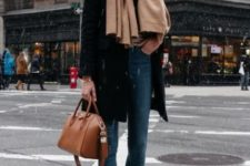 04 a simple look with blue cropped skinnies, black sock boots, a black coat and a brown bag