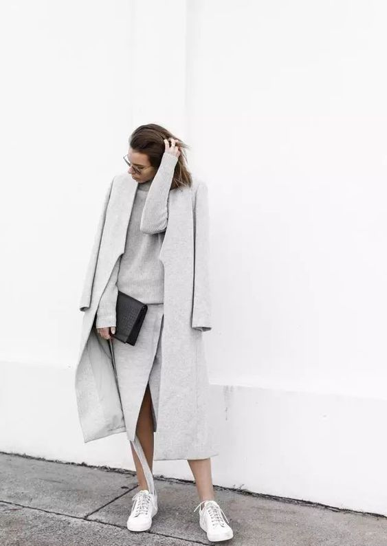 an elegant knit grey suit with a long sleeve top and a midi wrap skirt, a grey coat and white sneakers