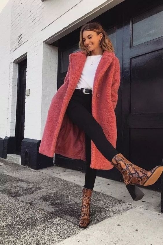 black skinnies, a white top, snake print boots and a pink faux fur coat for a bright winter outfit