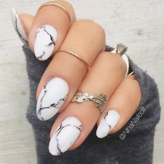 chic white marble nails are a trendy idea not only for winter but also for other seasons, too