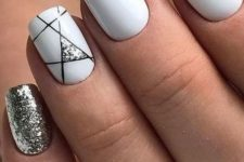 05 a glossy white manicure with a silver glitter nail and a geometric accent one with black lines