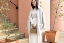 05 a stylish look with a white A-line skirt, a neutral top, blush shoes, an oversized fluffy cardigan and a tan bag